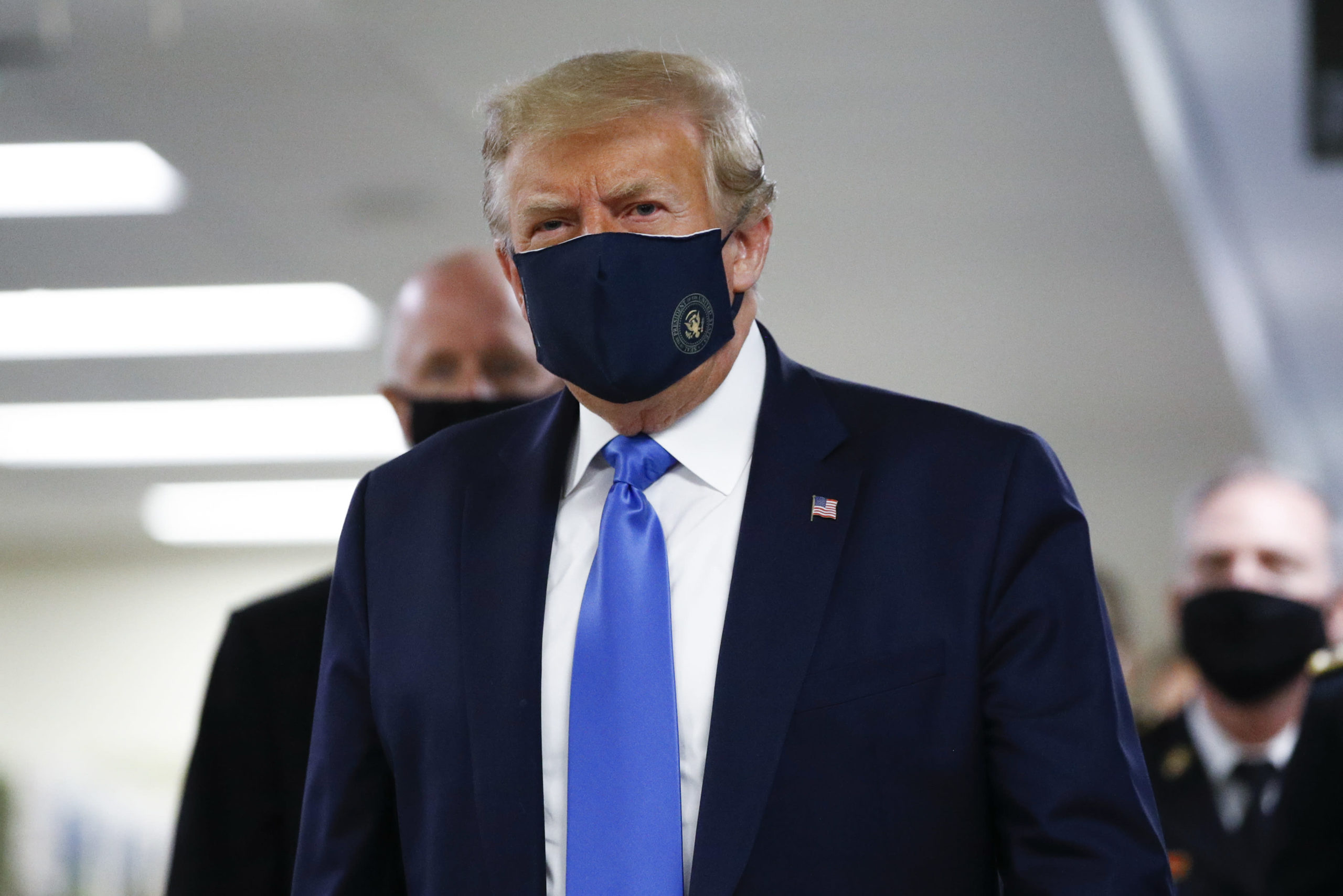 Trump wears coronavirus masks throughout public go to to Walter Reed army hospital