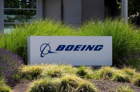 Boeing posts smaller loss as plane deliveries enhance