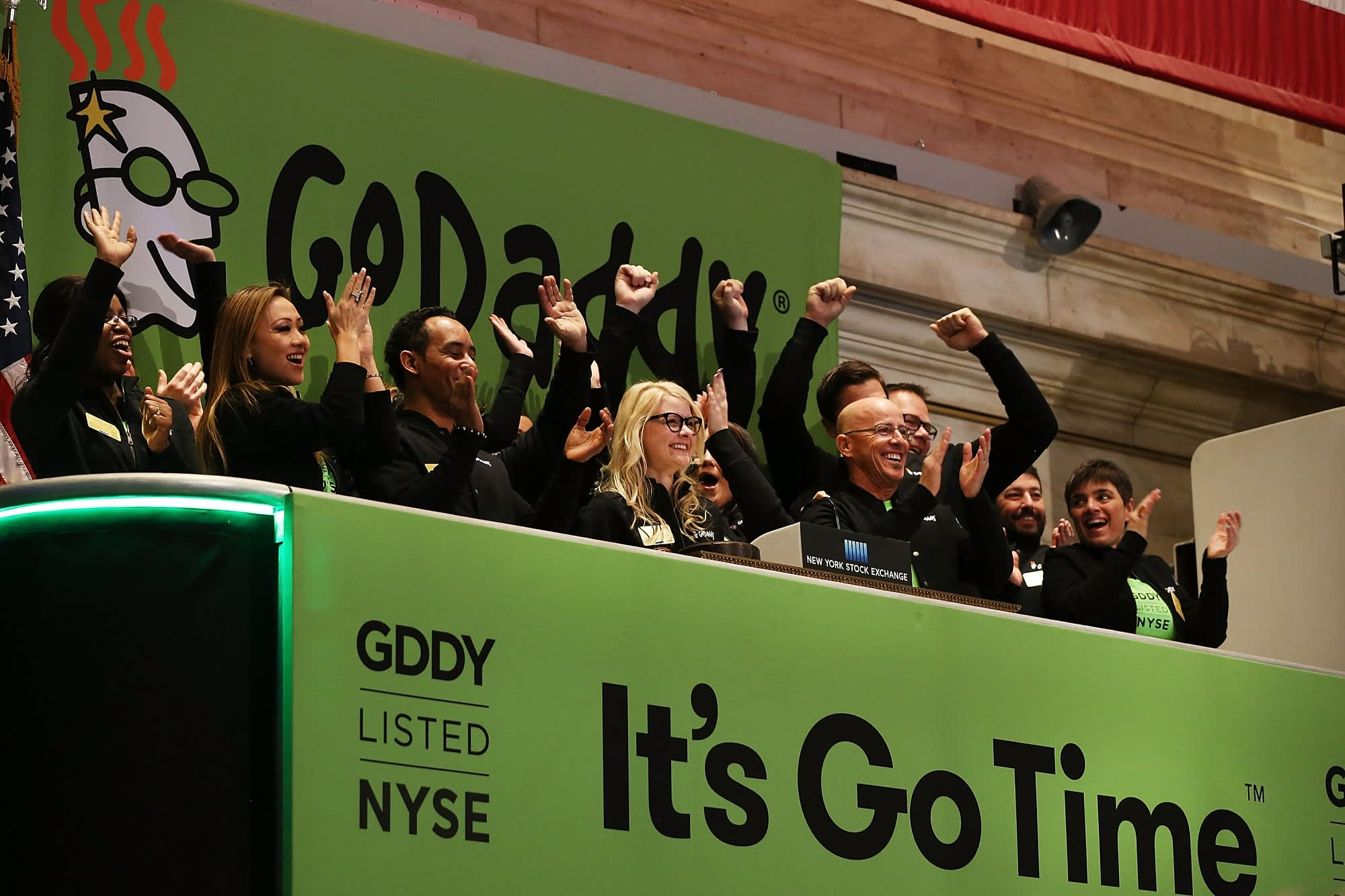 Wall Road analysts say purchase shares like GoDaddy & Carvana