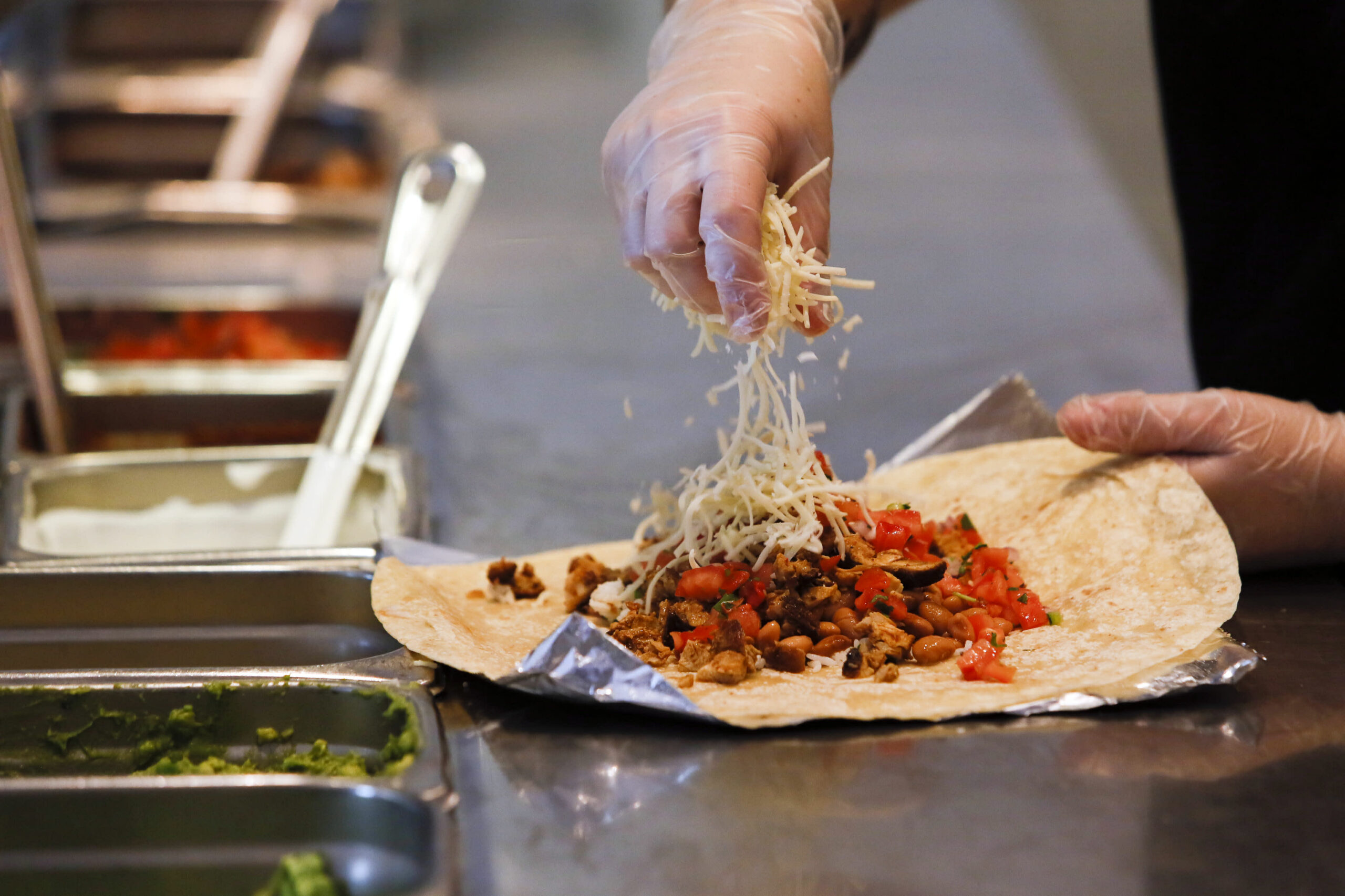 Chipotle hikes costs to cowl the price of elevating wages