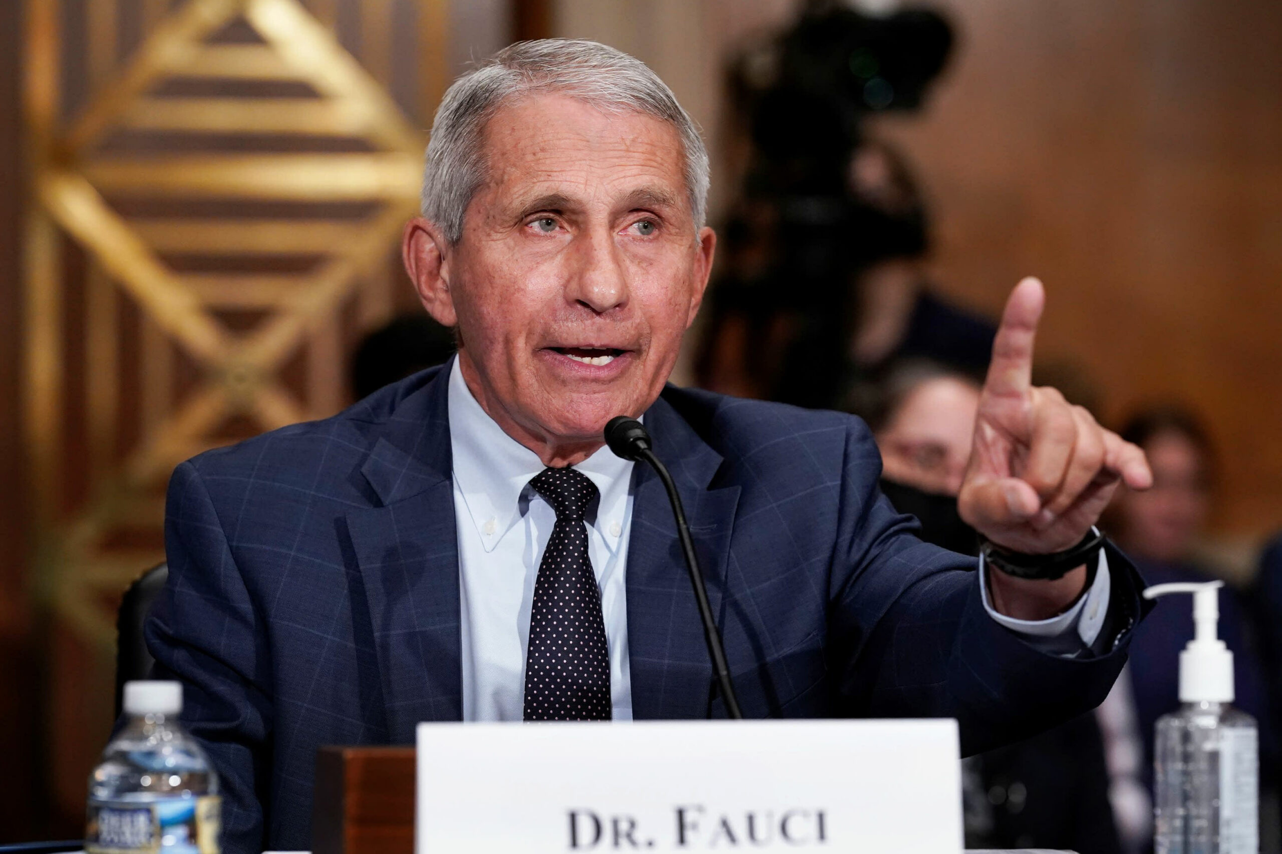 Fauci says vaccinated individuals 'may wish to take into account' sporting masks indoors
